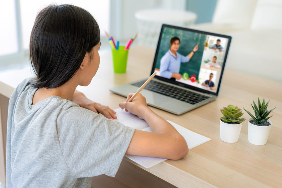 asian-girl-student-video-conference-e-learning-with-teacher-classmates-computer-living-room-home (1).jpeg
